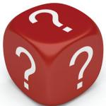 Красный куб с закруглёнными углами и белыми знаками вопроса на сторонах